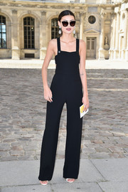 Amalie Gassmann looked oh-so-slim in her black jumpsuit during the Dior fashion show.