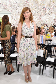 Louise Bourgoin oozed feminine charm in this floral wrap dress during the Dior Couture fashion show.