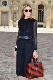 Olivia Palermo's two-tone crocodile tote and black coat at the Dior fashion show were a flawless pairing.