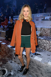 Florrie attended the H&M fashion show wearing a utilitarian-chic orange jacket, which contrasted nicely with her green shorts.