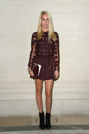 Princess Maria Olympia of Greece showed off miles of leg in a plum-colored mini dress during the Valentino Couture fashion show.