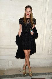 Eugenie Niarchos cut a youthful figure in this beaded LBD at the Valentino Couture fashion show.
