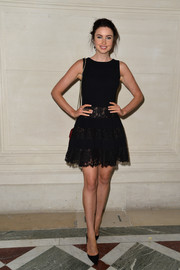 Emma Miller was cute and flirty in a lace-panel LBD during the Valentino Couture fashion show.
