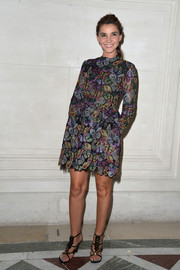 Clotilde Courau added a touch of edge with a pair of chevron-accented gladiator heels.