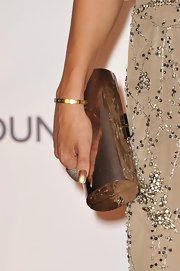 Vanessa stuck to a glowing gold look on the red carpet when she accessorized her jumpsuit with a golden clutch.