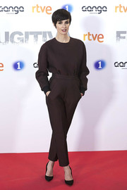Paz Vega kept it conservative in a long-sleeve burgundy jumpsuit at the premiere of 'Fugitiva.'