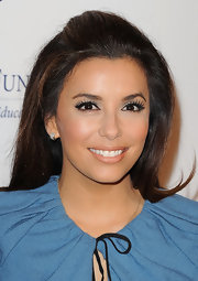 Eva Longoria's mile-long lash look can be recreated by applying a sweep of black liquid liner along the upper lash lines and then a pair of feathery false lashes. However, if you have an aversion to messing around with lash glue try a product like Maybelline Lash Stiletto Mascara for great lengths and tons of volume.