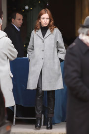 Lea wears a classy wool coat in a soft heather gray.