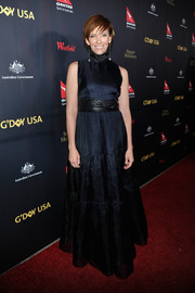 Toni Collette charmed in a sleeveless black high-neck gown with a wide leather belt at the G'Day USA Black Tie Gala.