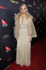 Nicole Richie layered an Opening Ceremony shearling jacket over her gown for added drama.
