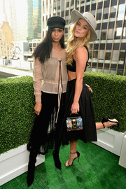 Chanel Iman completed her sheer look with a black skirt.