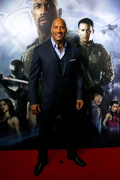Dwayne Johnson classed up his red carpet look with this pinstripe three-piece suit.