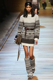 Chanel dons a Dolce and Gabbana fair isle sweater dress with a large leather belt for the D&G runway.
