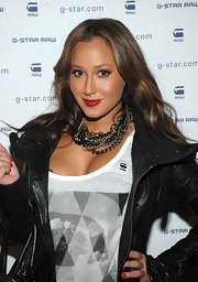 Adrienne Bailon added a rockin' touch to her look with a black-and-gold chain necklace.