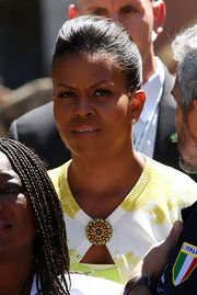 Michelle Obama was flawlessly coiffed in a loose bun during a visit to the Palazzo del Governo of L'Aquila.