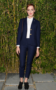 Jena Malone attended the GANT Rugger collection presentation wearing a cropped navy pantsuit from the label.