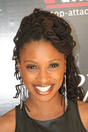 Shanola Hampton visited the pre-Oscar Awards luxury gift lounge wearing her hair in swirls of dreadlocks.