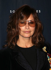 Gina Gershon sported high-volume waves with side-swept bangs at the 2018 GO Campaign Gala.
