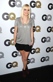 Anna Faris attended the GQ Men of the Year party in burgundy suede ankle boots. The boots added color to her sparkly black evening shorts.