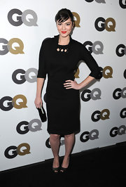 Mary wore a little black dress with a lattice neckline design and a little overlay jacket. Very retro!