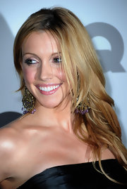 Katie Cassidy rocked her long honey blond locks in a simple straight 'do with a modern center part.
