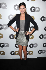 Odette Yustman gave her sparkly cocktail dress a masculine vibe in on-trend black suede ankle boots. An oversize blazer completes the look.
