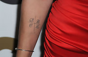 Jaimie has ink on her right arm with the letters B/D/L/M.
