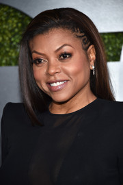 Taraji P. Henson wore her hair straight with small, swirly braids on one side during the GQ 20th Anniversary Men of the Year party.