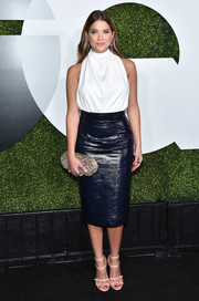 Ashley Benson added a touch of print with an oval python clutch.