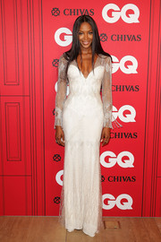 Naomi Campbell played up her stunning figure in a white Roberto Cavalli gown with a plunging neckline and sheer sleeves during the GQ Men of the Year Awards.