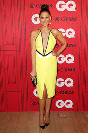 Sally Obermeder donned a modern bright yellow dress with a sheer front plunge for the GQ Men of the Year Awards.