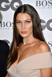 Bella Hadid rounded out her elegant look with a layered diamond choker.