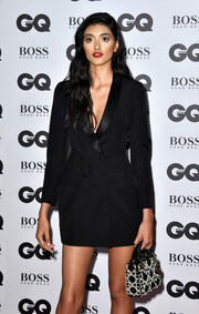 Neelam Gill paired a pearl-embellished purse with a tuxedo dress, both by Dior, for the GQ Men of the Year Awards.