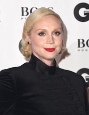 Gwendoline Christie styled her short hair with flippy ends for the 2018 GQ Men of the Year Awards.