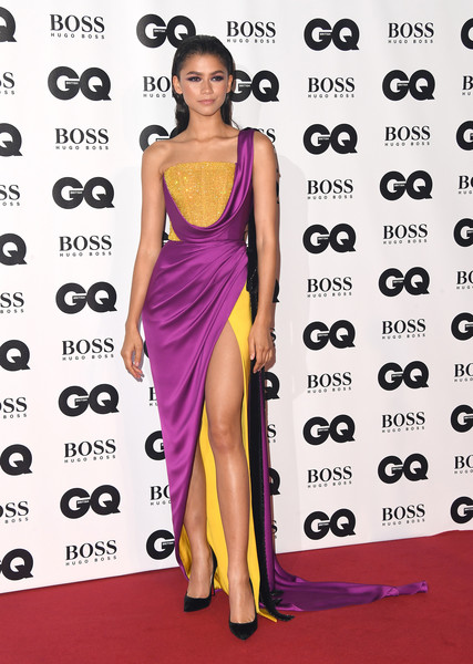 Zendaya Coleman went for exotic glamour in a color-block one-shoulder gown by Ralph & Russo Couture at the 2018 GQ Men of the Year Awards.