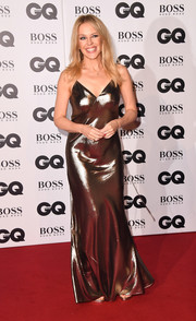 Kylie Minogue went for high shine in a gold slip gown at the 2018 GQ Men of the Year Awards.