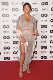Chrissy Teigen was boudoir-glam in a beaded and fringed tunic dress by Labourjoisie x Lyla Dumont at the 2018 GQ Men of the Year Awards.