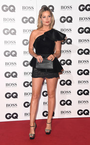 A simple black leather clutch completed Laura Whitmore's attire.