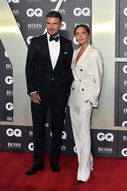 Victoria Beckham worked a sharp white pantsuit from her own label at the 2019 GQ Men of the Year Awards.