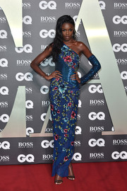Leomie Anderson glammed up in a one-shoulder floral column dress by Rami Kadi Couture for the 2019 GQ Men of the Year Awards.