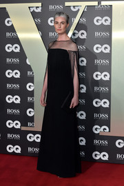 Erin O'Connor chose a black gown with a mesh yoke and fringed sleeves for the 2019 GQ Men of the Year Awards.
