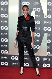 Winnie Harlow glammed up her suit with a pair of crystal-buckle pumps by Roger Vivier.