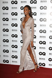 Jourdan Dunn oozed sex appeal in this sultry silver evening dress and red sandals combo at the GQ Men of the Year Awards.
