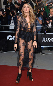 Opting for a not-so-basic LBD for her GQ Men of the Year Awards look, Cara Delevingne stole the show in a black Burberry Prorsum lace dress that showed way too much skin.