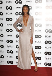 Jourdan Dunn looked downright stunning in a long-sleeve silver evening dress with a revealing neckline during the GQ Men of the Year Awards.