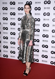 Erin O'Connor sealed off her look with a pair of furry ankle-tie sandals.