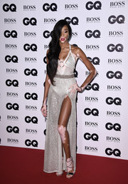 Winnie Harlow finished off her red carpet look with strappy silver sandals.