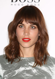 Alexa Chung sported a billowy shoulder-length hairstyle with thick bangs when she attended the GQ Men of the Year Awards.