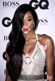 Winnie Harlow wore her long tresses swept to the side at the GQ Men of the Year Awards.