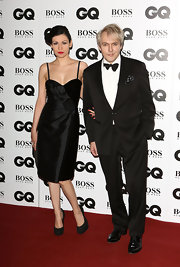 Nefer Suvio donned a sultry little black dress with rosette detailing for the GQ Men of the Year Awards.